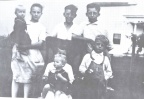 The 7 DeVore sibblings...front: Marcella holding Charles, James.  second row: Mary holding Andrea, Tom, and John. -1930 in Brown