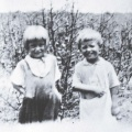 Andrea says this picture is of her and Charles picking cotton.  I guess farm children are never too young to help out.