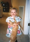 This is how NOT to hold a kitty.  Sarah Whitlock holding Sunny, when she was about 3 years old.  She's 6 now. 11-20-2002Cat's